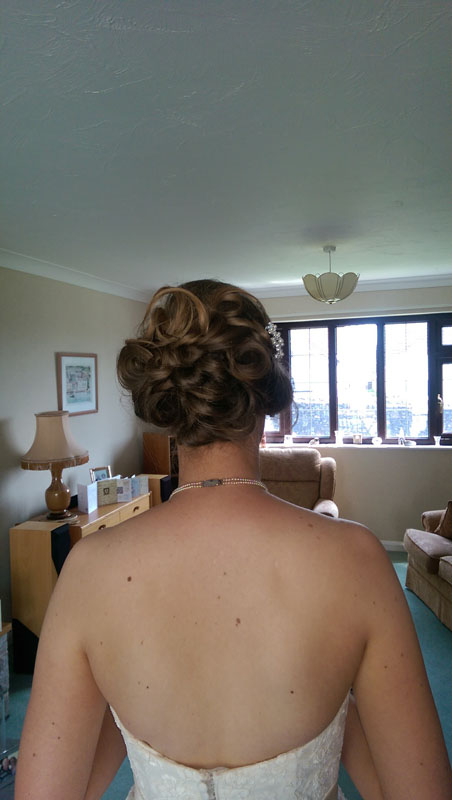 lady with hair up style on her wedding day