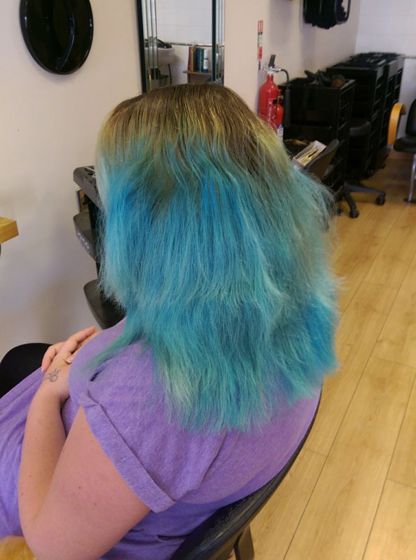lady before hair colouring with bright blue hair