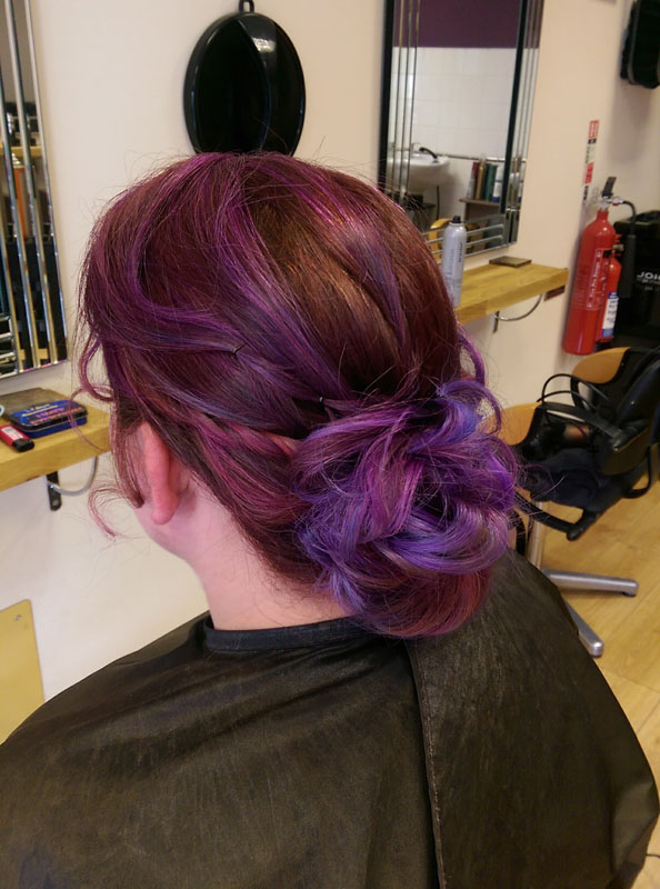 lady with long brown and purple coloured hair up