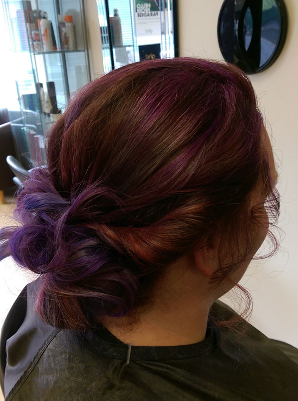 lady with short brown and purple coloured hair