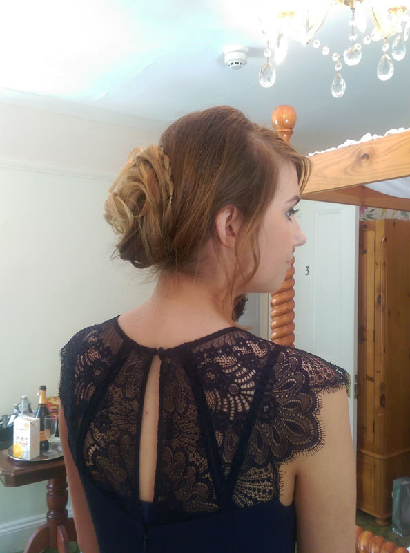lady with hairup style for bridesmaid at a wedding