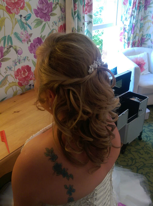 lady with hair up styling ready for wedding