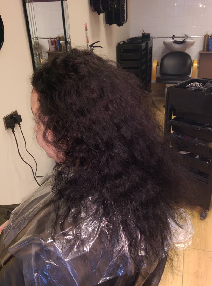 lady with curly purple hair before keratin therapy
