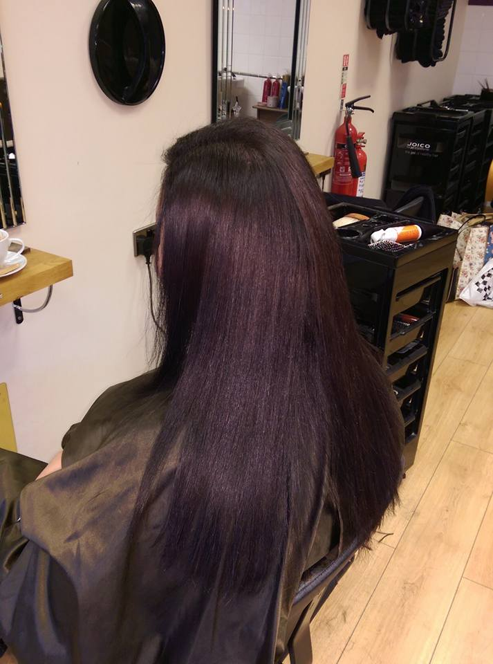 lady with long purple straight hair after keratin therapy